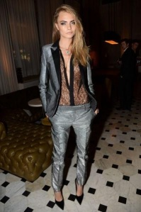 The sheer top adds a sultry edge to the metallic suit.