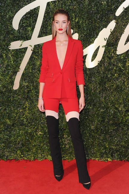 Supermodel and personal muse Rosie Huntington-Whiteley looks absolutely flawless in this Antonio Berardi suit. This is such a remarkable design, the way the trousers arch elongate her legs in such a way that it would be utterly impossible not to do a double-take.